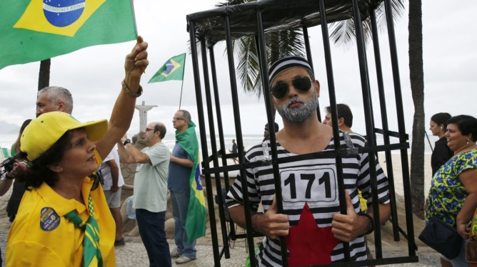 Protesters take part in a demonstration to demand the impeachment of suspended President Dilma Rousseff on Copacabana, Rio de Janeiro
