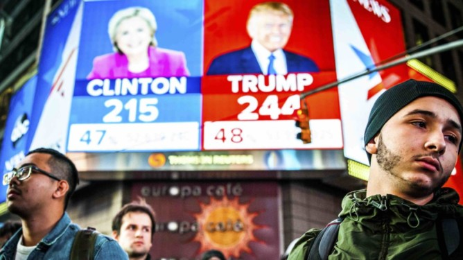 FILE-- People watch election results at Times Square in New York, Nov. 9, 2016.  Clinton has followed Al Gore as the second Democratic presidential candidate in modern history to be defeated by a Republican who earned fewer votes, in his case by George W. Bush. Even President-elect Donald Trump, who won the electoral vote but lost the popular vote, called the system '‰úa disaster for a democracy'‰ù in 2012.  (George Etheredge/The New York Times)